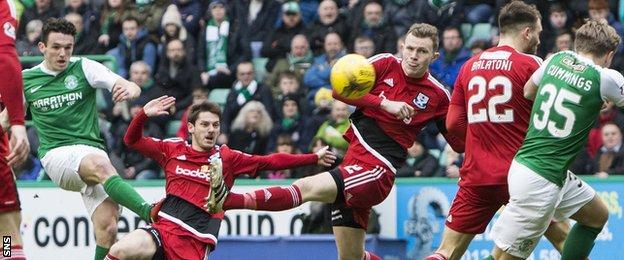 John McGinn scored a delightful goal to send Hibs 1-0 against Ayr United