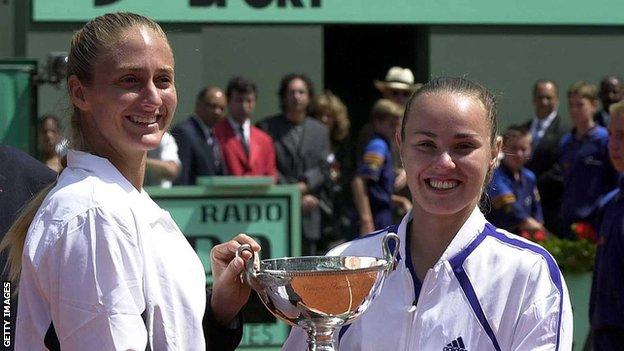 Mary Pierce and Martina Hingis lift the French Open women's doubles title in 2000