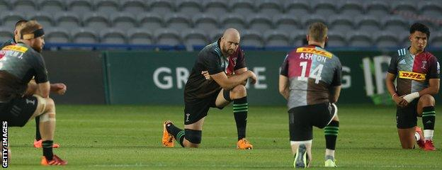 Harlequins players take a knee