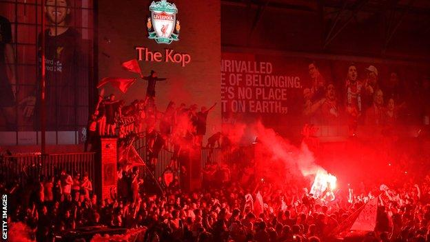 Liverpool fans celebrate winning the league at Anfield