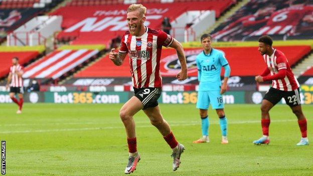 Oli McBurnie celebrates scoring against Tottenham