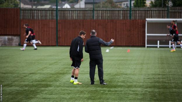 Edinburgh City manager Gary Jardine discusses tactics with a member of his squad
