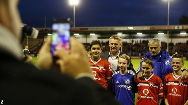 Chelsea boss Jose Mouninho lines up with opposite number Dean Smith before Tuesday's 4-1 win at Walsall