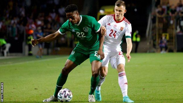 Chiedozie Ogbene of Republic of Ireland is challenged by Szabolcs Schon after being introduced
