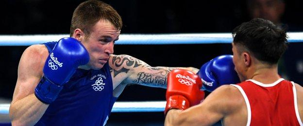 Steven Donnelly lands a punch during his Olympic Games victory over Tuvshinbat Byamba