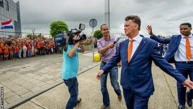 Louis van Gaal returns to the Netherlands after leading his country to third place at the 2014 World Cup in Brazil