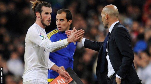 Real Madrid forward Gareth Bale and boss Zinedine Zidane (right)