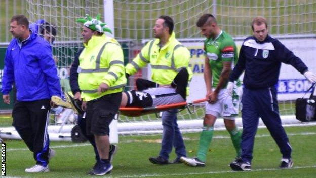 Chris Tardif stretchered off