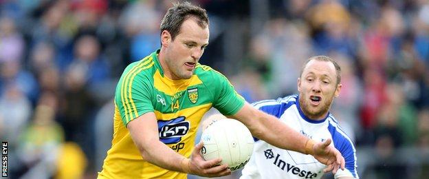 Michael Murphy attempts to get in a shot despite the attentions of Monaghan's Vinny Corey
