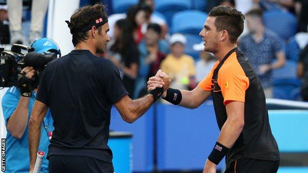 Roger Federer and Cameron Norrie shake hands at the net