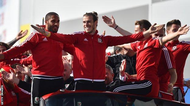 Wales squad on an open-top bus