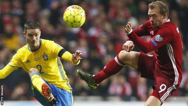 Celtic's Mikael Lustig (left) in action for Sweden against Denmark