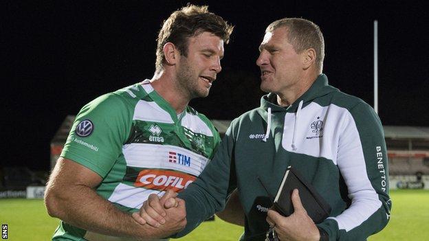 Benetton's Fuser Marco celebrates with director of rugby Marius Goosen
