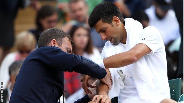 Novak Djokovic has treatment on his elbow