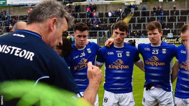 McGleenan talks to his Cavan team after their 2017 Ulster Championship defeat by Monaghan