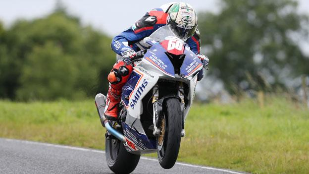 Peter Hickson on the way to winning the opening Superstock race