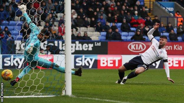 Gary Madine scored in his last match for Bolton to earn a 1-1 draw against Ipswich