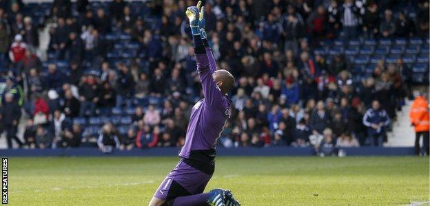 Heurelho Gomes celebrates one of his two penalty saves