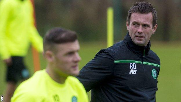 Celtic manager Ronny Deila looks concerned in training