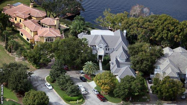 WINDERMERE, FL - DECEMBER 01: Tiger Woods' home (centre) is seen on December 1, 2009 in Windermere, Florida. Woods has not spoken with media or Florida Highway Patrol since he drove his SUV into a fire hydrant and a tree near the entrance to his neighbour's driveway, seen to the right, in the early hours of November 27. (Photo by Joe Raedle/Getty Images)