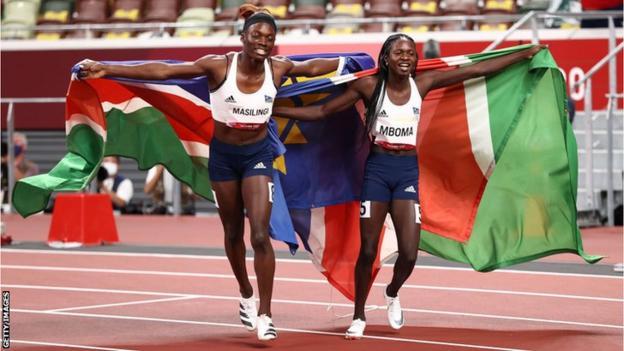 Athletes Beatrice Maslingi (left) and compatriot Christine Mboma celebrate with Namibian flags