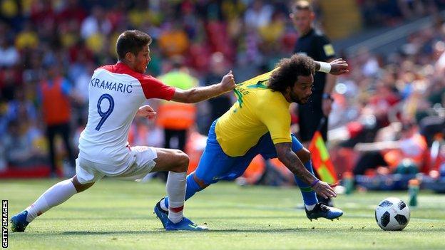 Hoffenheim forward Kramaric hauls back the run of Real Madrid defender Marcelo