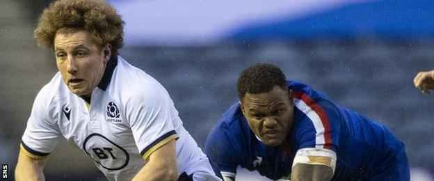 Scotland's Duncan Weir drives forward away from France's Virimi Vakatawa