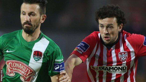 Liam Miller of Cork City in action against Barry McNamee of Derry City