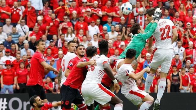 Fabian Schar heads in goalkeeper Etrit Berisha flapped at Xherdan Shaqiri's corner