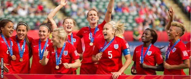 England women celebrate third place at the World Cup