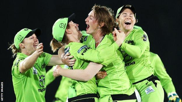 Sammy-Jo Johnson is mobbed after taking the wicket which sealed Sydney Thunder's place in the final