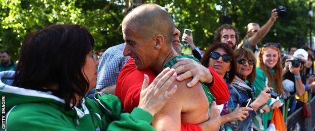 Robert Heffernan is embraced by family and friends and Sunday's race