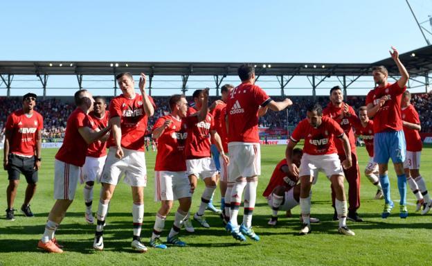 Bayern Munich players celebrate winning the Bundesliga for a record fourth successive season