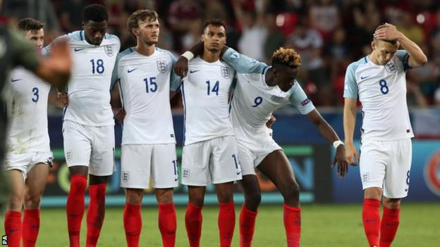 England's players react after losing to Germany in the semi-final of the European Under-21 Championship