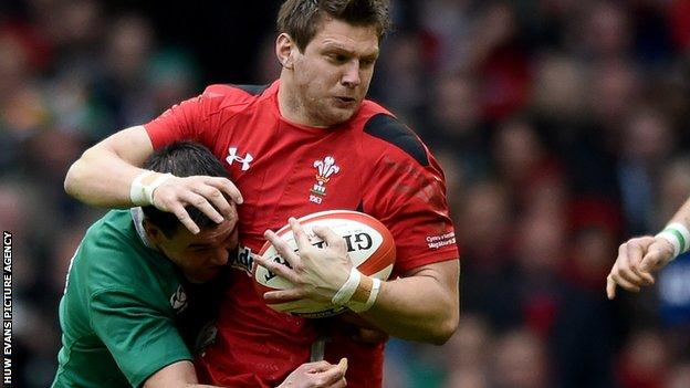 Johnny Sexton tackles Dan Biggar during Wales' win against Ireland in March 2015