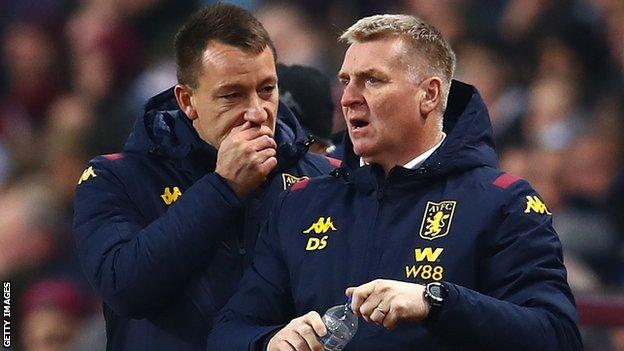 Aston Villa boss Dean Smith (right) with assistant manager John Terry during a cup tie with Liverpool