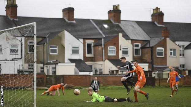 An adult amateur football match