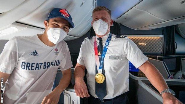 Joe Choong with a British Airways staff member