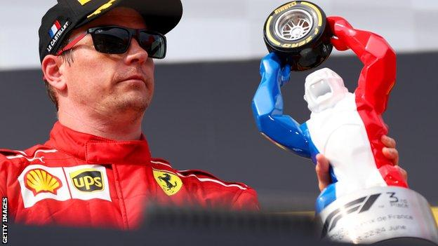 Kimi Raikkonen and the French Grand Prix trophy in 2018