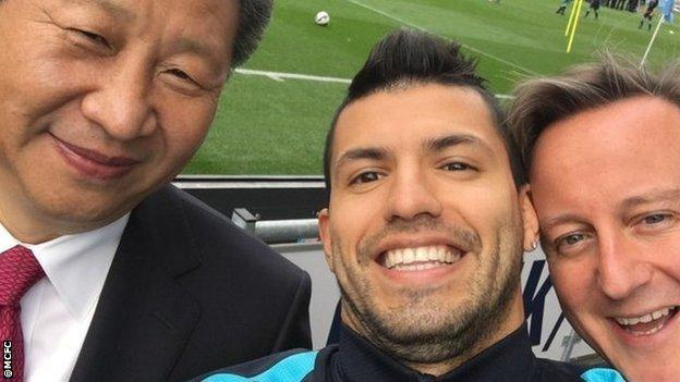 China president Xi Jingping (left) and Prime Minister David Cameron (right) with Sergio Aguero
