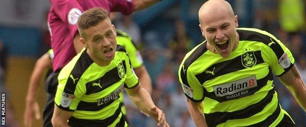 Aaron Mooy celebrates his goal for Huddersfield