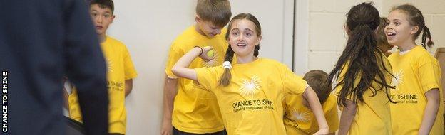 Girls and boys taking part in a Chance to Shine event with James Taylor
