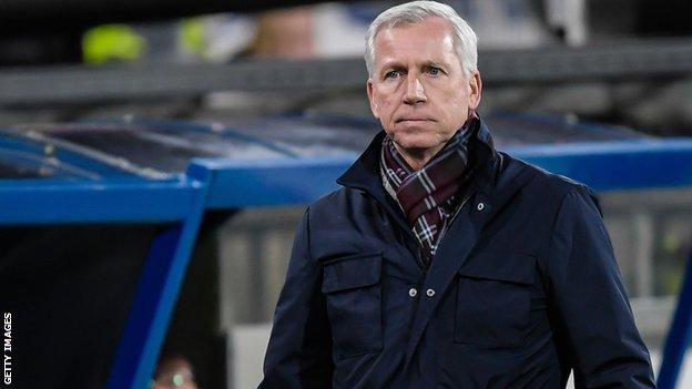 Alan Pardew looks on from the touchline while in charge of Den Haag