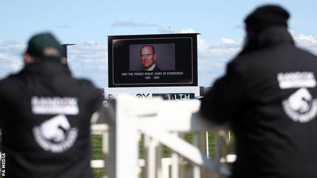 A tribute on a big screen for the late Prince Philip, Duke of Edinburgh, ahead of Ladies Day of the 2021 Randox Health Grand National Festival at Aintree Racecourse