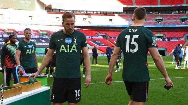 Harry Kane collects his losers' medal after Sunday's Carabao Cup final