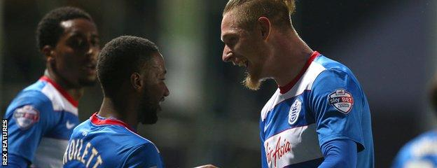 Junior Hoilett celebrates with Sebastian Polter after give QPR the lead