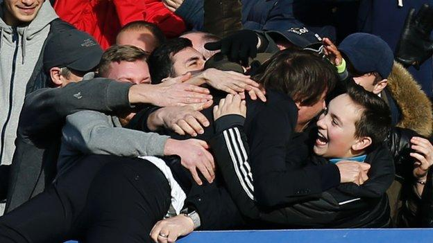 Chelsea manager Antonio Conte celebrates with fans