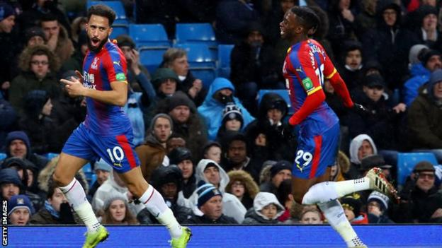 Andros Townsend celebrates scoring against Manchester City