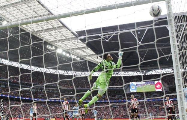 Yaya Toure scores City's equaliser against Sunderland in the 2014 League Cup final