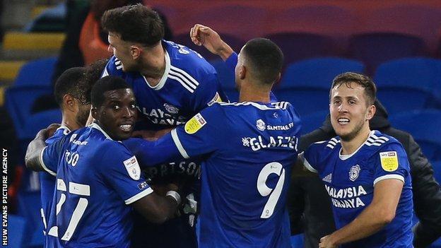 Cardiff players celebrate a goal